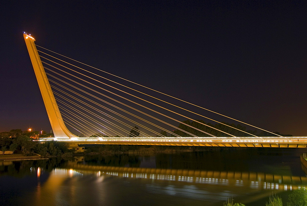 Alamillo Bridge, Puente del Alamillo, over Guadalquivir River, at night, built as part of infrastructure improvements for Expo 92, Seville, Spain, Europe