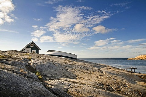 Green cabin with row boat, Smoegen, Bohuslaen, Sweden