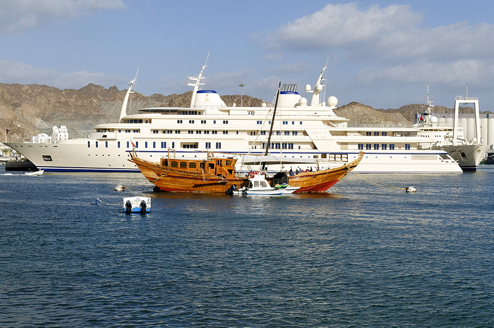 Old dhow and Sultan Qaboos royal yacht, Mutrah harbour, Muscat, Sultanate of Oman, Arabia, Middle East