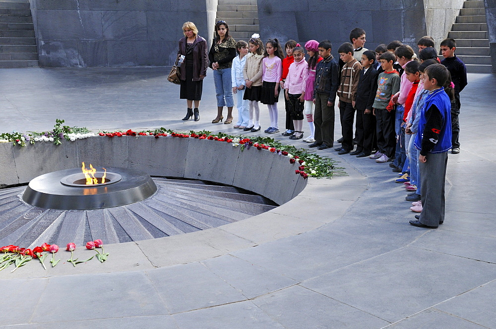 School children in the Armenian Genocide Memorial Tsitsernakaberd with eternal flame, Yerevan, Armenia, Asia