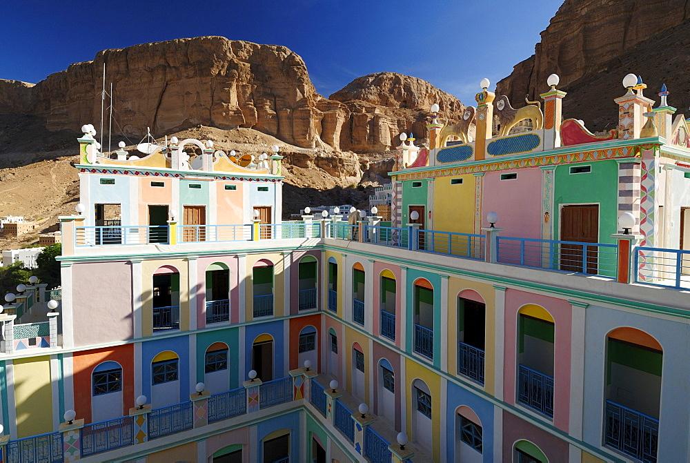Colorful adobe Hotel Bait, Beit Bugshan, Khaylla, Khaylah village, Wadi Doan, Wadi Hadramaut, Yemen, Arabia, Southwest Asia