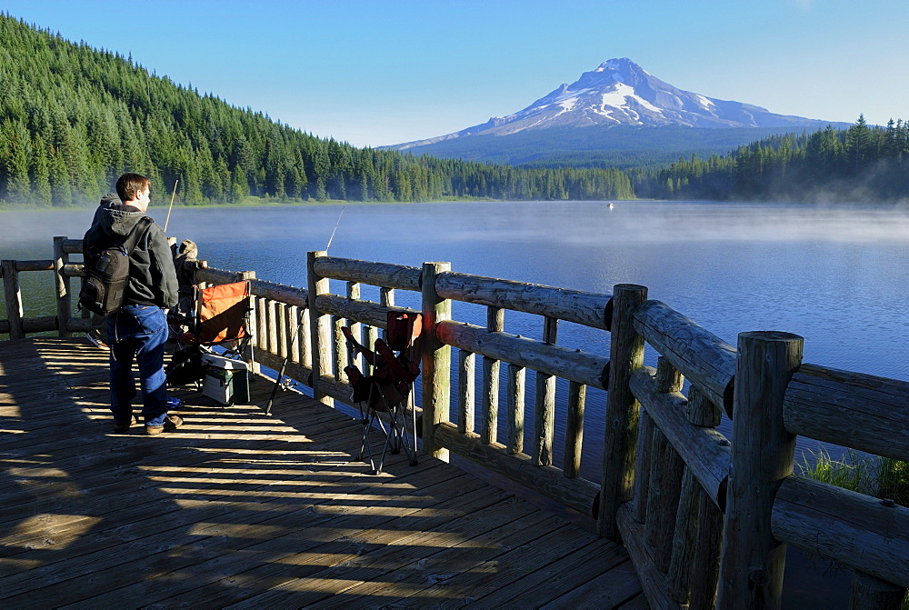 Anglers at Trillium Lake with Mount Hood volcano, Cascade Range, Oregon, USA