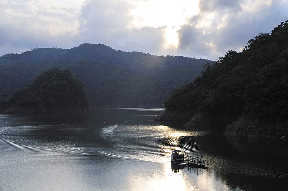 Reservoir of the La Miel hydroelectric power plant at sunset, Caldas, Colombia, South America
