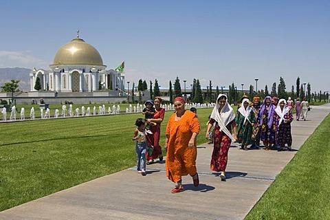 Ashgabat, women in front of the Mausoleum of President Turkmenbasy, Turkmenistan