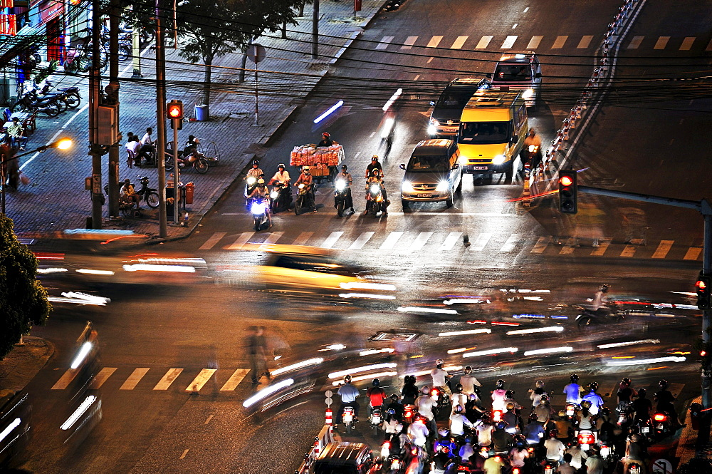 Road junction with traffic at night, Ho Chi Minh City, Saigon, Vietnam, Asia