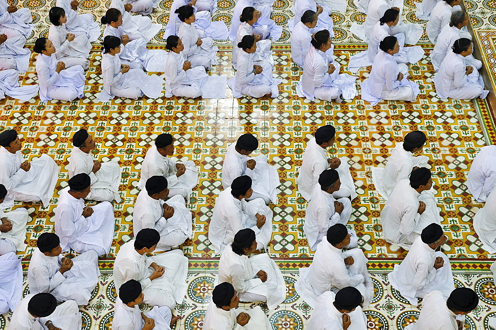 Ceremonial midday prayer in the Cao Dai temple, Tay Ninh, Vietnam, Asia