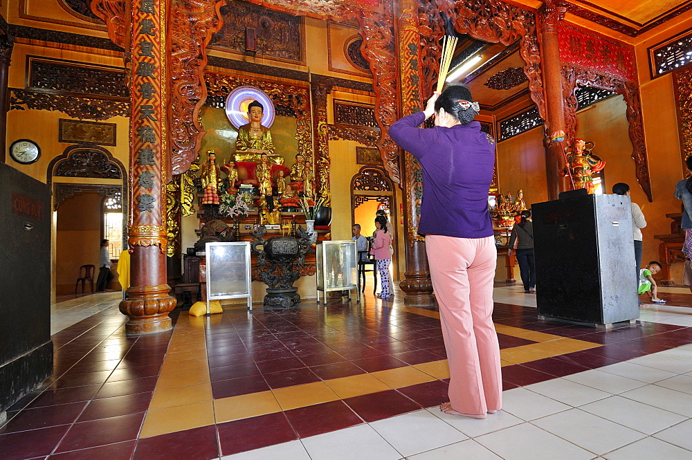 People praying in a Buddhist temple on the mountain of the black woman, Nui Ba Den, Tay Ninh, Vietnam, Asia