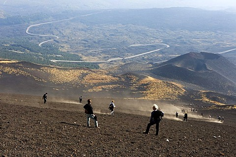 Tourists descending from Mount Etna, Sicily, Italy