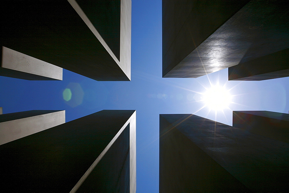 Sun over the concrete slabs or stelae at the Memorial to the Murdered Jews of Europe, Berlin, Germany, Europe