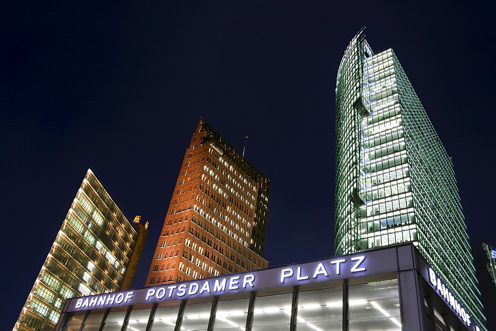High-rise buildings, Debis, Kolhoff and DB Tower skyscrapers and entrance to the S-Bahn train station at Potsdamer Platz, in Berlin, Germany, Europe