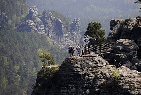 Tourists on viewing platform and rock formations of the Bastei, Saxon Switzerland, Elbe Sandstone Mountains, Free State of Saxony, Germany, Europe