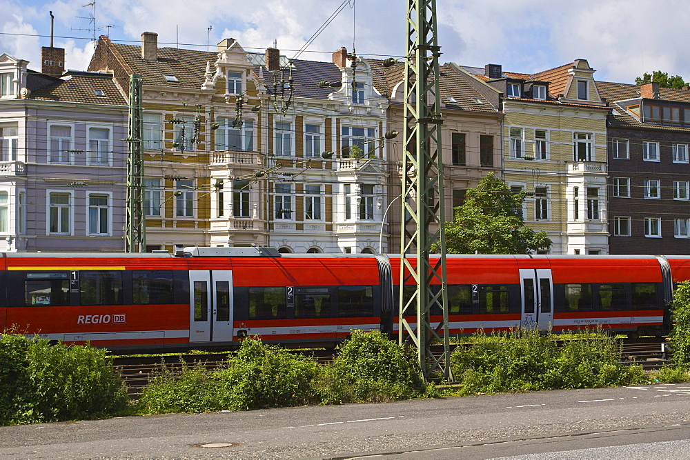 Regional train from Deutsche Bahn AG in front of Gruenderzeit buildings, from the Founder's Epoch period, in the city of Bonn, North Rhine-Westphalia, Germany, Europe