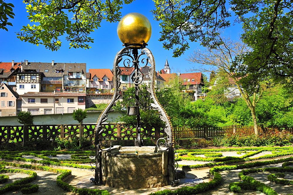 Draw well in the Katz'scher Garten park, Gernsbach, Murgtal, Black Forest, Baden-Wuerttemberg, Germany, Europe