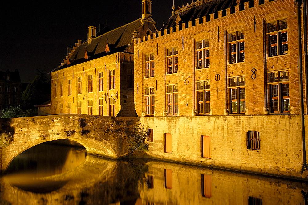 Water reflection, River Dijver, Bruges at night, Flanders, Belgium, Europe