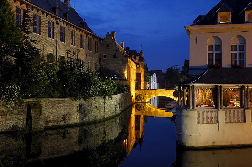 Water reflection, River Dijver, Bruges at dusk, Flanders, Belgium, Europe