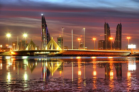 Skyline of the Corniche as seen from King Faisal Highway, Muharraq side, World Trade Center buildings, left, beside the towers of the Financial Harbour Complex, Muharriq Bridge at the Sheikh Isa Causeway, capital city, Manama, Kingdom of Bahrain, Persian