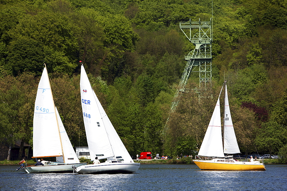 Former coal mine winding tower of mine Carl Funke, water sports on the Baldeneysee storage lake, river Ruhr, Essen, North Rhine-Westphalia, Germany, Europe