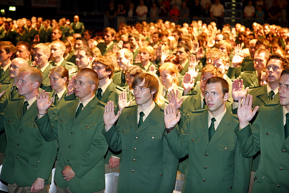 Swearing in of 1100 new police officers in the Koeln Arena stadium, Cologne, North Rhine-Westphalia, Germany, Europe