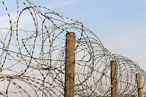 Fence, secured with NATO wire, barbed wire