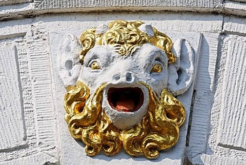 Head of a mythical creature with an open mouth and a golden beard, facade relief on a city palace from the 17th century, Hoorn, Province of North Holland, Netherlands, Europe