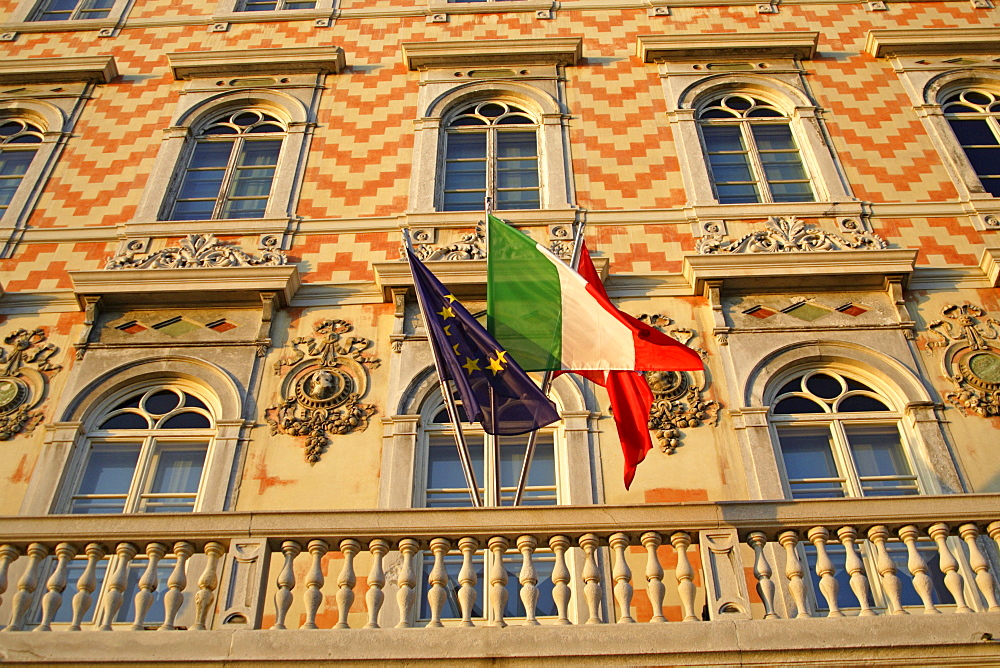 Decorative facade of the Museum of the Grand Canal with Italian and EU flags, Triest, Italy, Europe