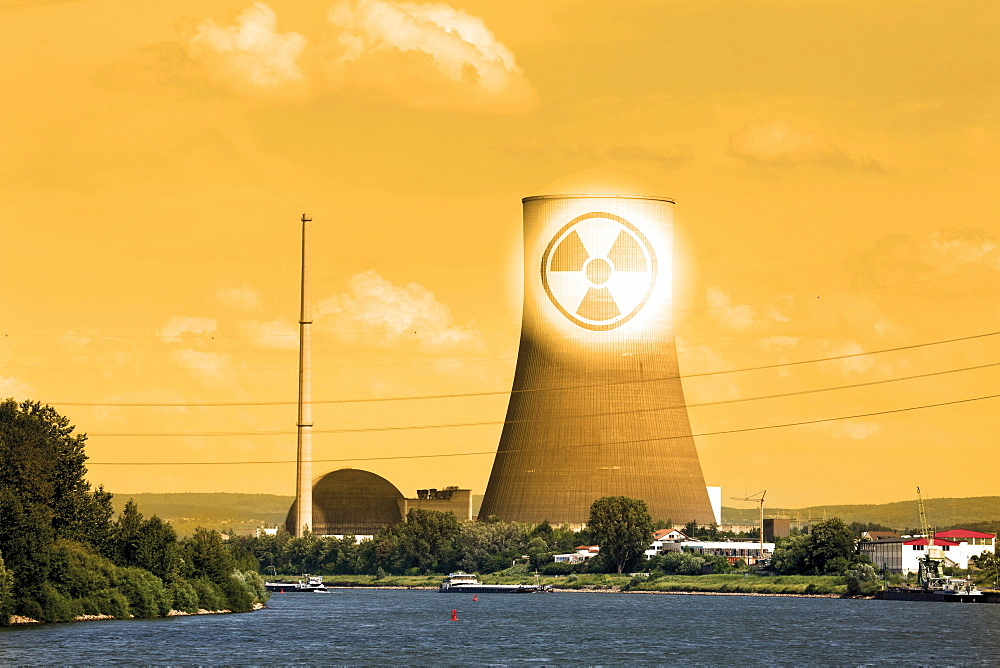 The closed nuclear power plant in Muehlheim-Kaerlich on Rhine River, composing, symbolic picture, radioactivity warning sign