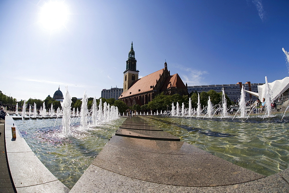 Brunnen der Voelkerfreundschaft' Fountain, Marienkirche Church in the back, taken with a fisheye lens, Berlin-Mitte, Germany, Europe