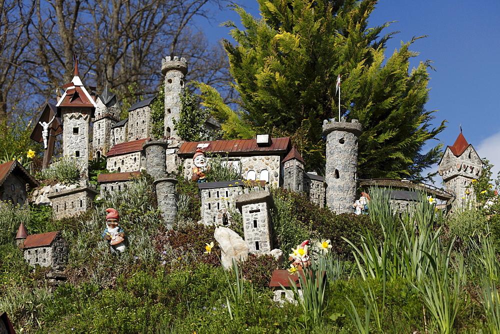 Garden gnomes and model castles in a garden in Sarleinsbach, Muehlviertel, Upper Austria, Austria, Europe