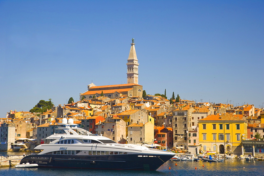 The southern harbour with motor yacht Sibelle against Rovinj historic centre, Istria, Croatia, Europe