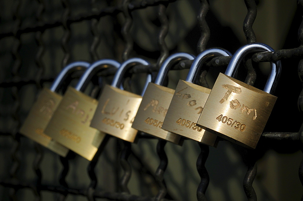 Padlocks as a symbol of friendship and love on the fence of the Hohenzollern bridge in Cologne, North Rhine-Westphalia, Germany, Europe