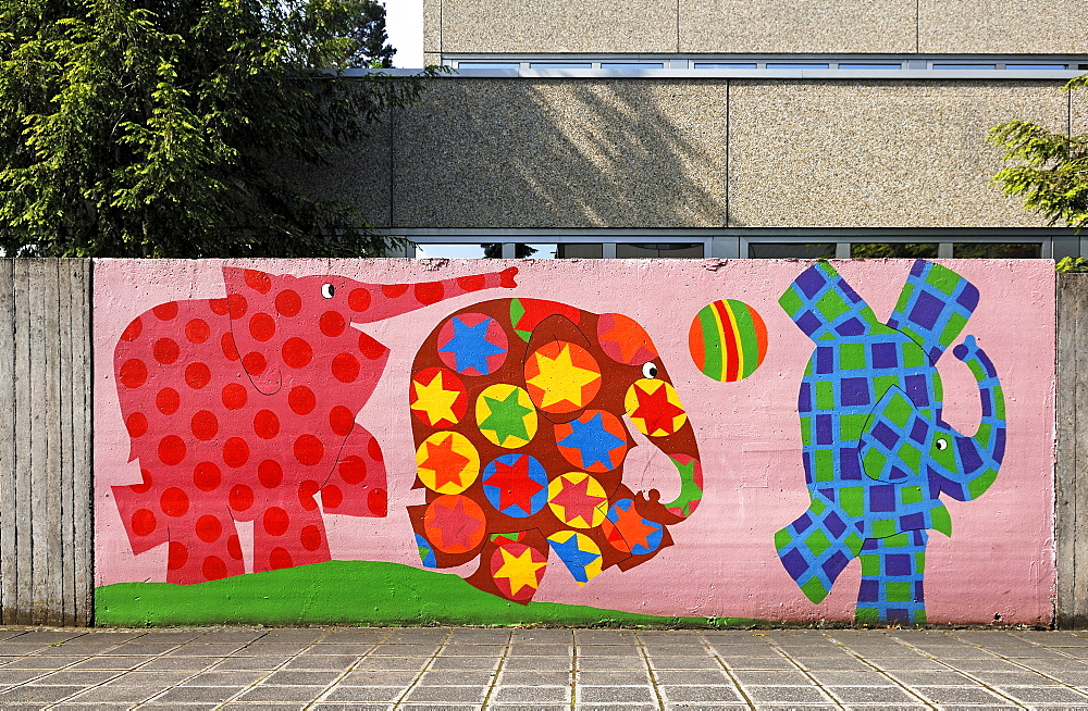 Colorful elephants on the wall of an elementary school, Nuremberg, Middle Franconia, Bavaria, Germany, Europe
