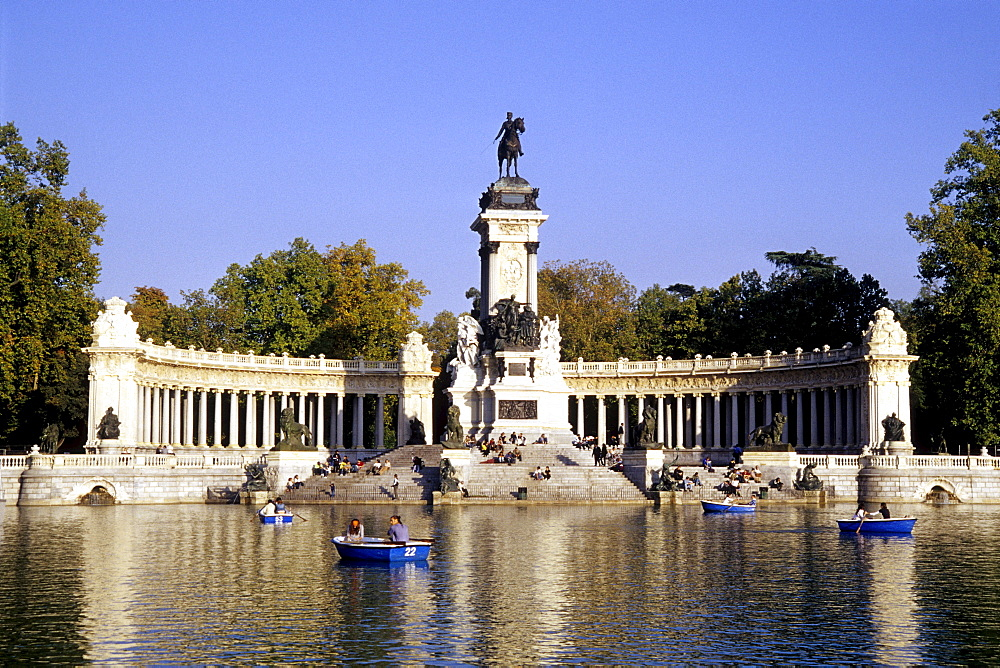 Colonnade and equestrian statue of the monument to Alfonso XII, Glorieta de la Sardana on Estanque, rowboats on the lake in the park, Parque del Retiro, Madrid, Spain, Europe