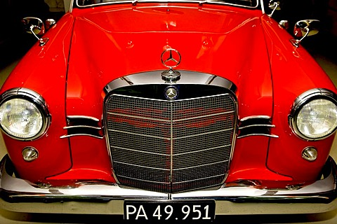 Front of an old red Mercedes car