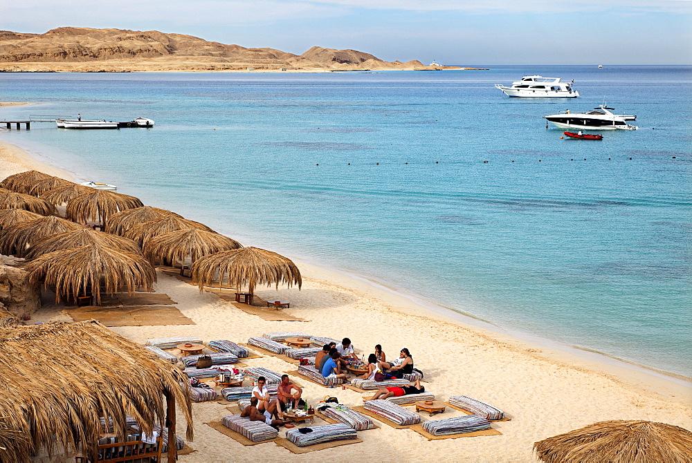 People at beach on pillow seats, beach, parasols, lagoon, swimmers, people, ships, Beach Mahmya, beach, Giftun Island, Hurghada, Egypt, Africa, Red Sea