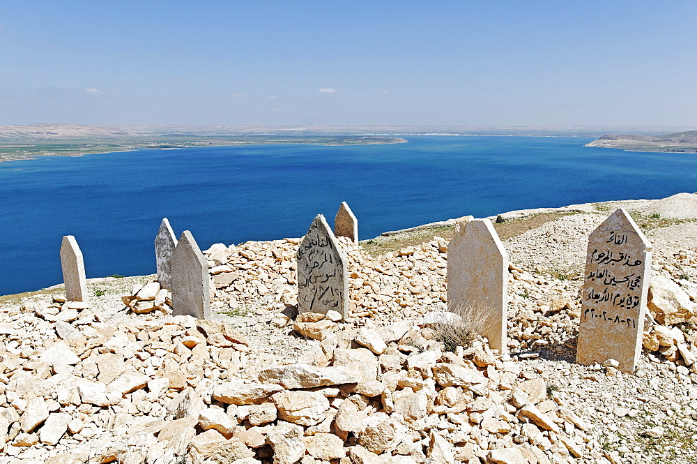 Cemetery on the mountain Jebel Arruda, in the back the Asad reservoir of the Euphrates, Syria, Asia