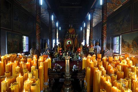 Candles and Buddha statue in Wat Phnom, Phnom Penh, Cambodia