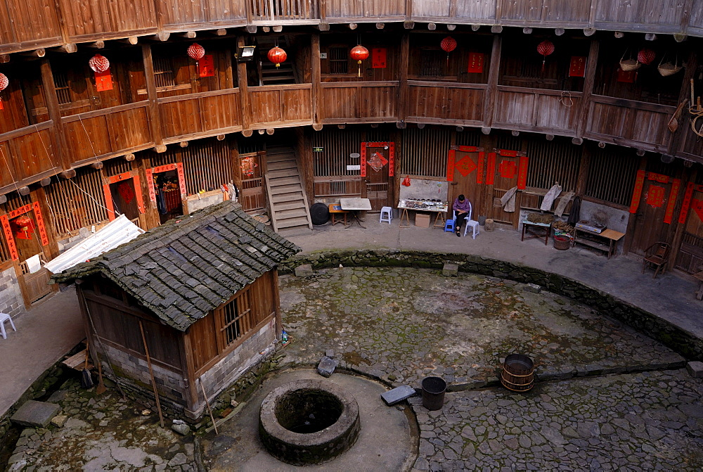 Courtyard with a fountain of a Tulou round house, dirt round houses, adobe round houses, the Chinese minority Hakka, near Yongding and Hukeng, Fujian, China