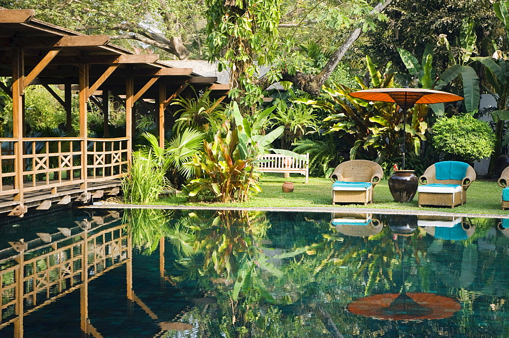 Deckchairs reflecting in the pool, The Governors Residence, luxury hotel, colonial hotel, Rangoon, Yangon, Burma, Myanmar, Asia