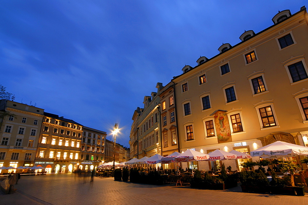Restaurants on the main or grand market square Rynek Glowny at night, Cracow, Poland