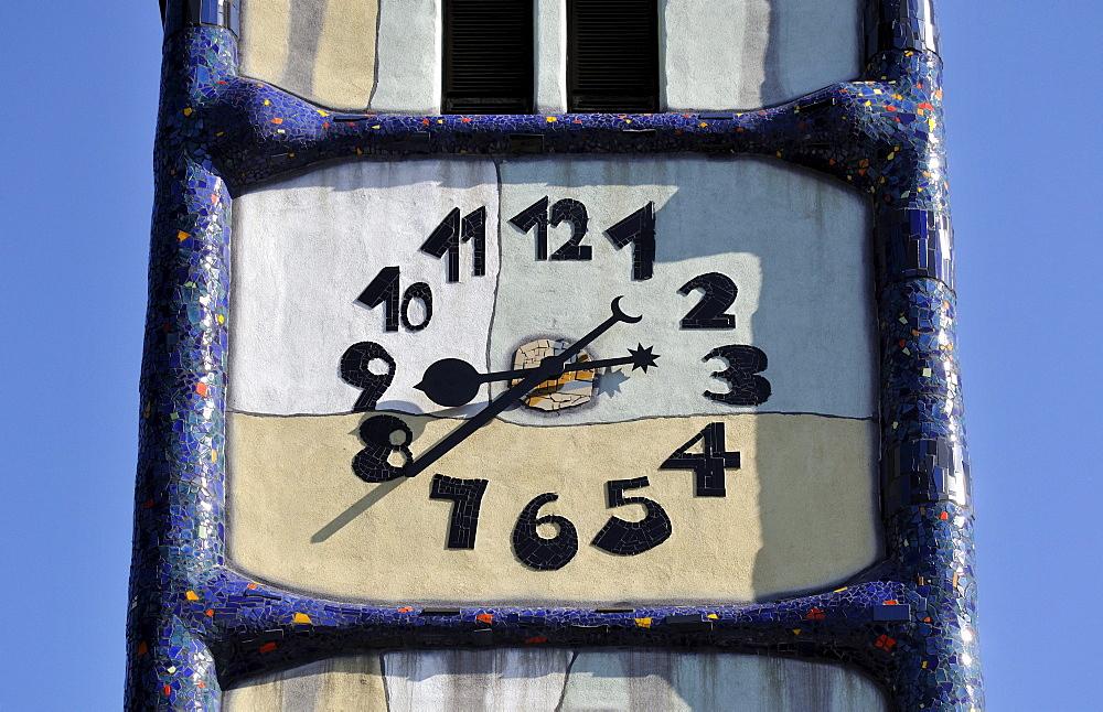 Detail of the clock at St. Barbara-Kirche, Church of Saint Barbara, renovated by Friedensreich Hundertwasser, in Baernbach, Styria, Austria, Europe