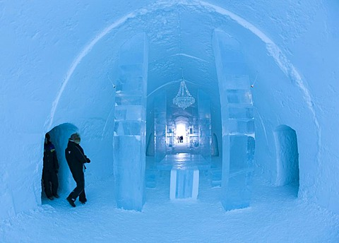 Long hall with a table and a chandelier made of ice, ice hotel of Jukkasjaervi, Lappland, Northern Sweden