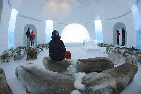 Tourists in the chapel belonging to the ice hotel, Jukkasjaervi, Lappland, Northern Sweden