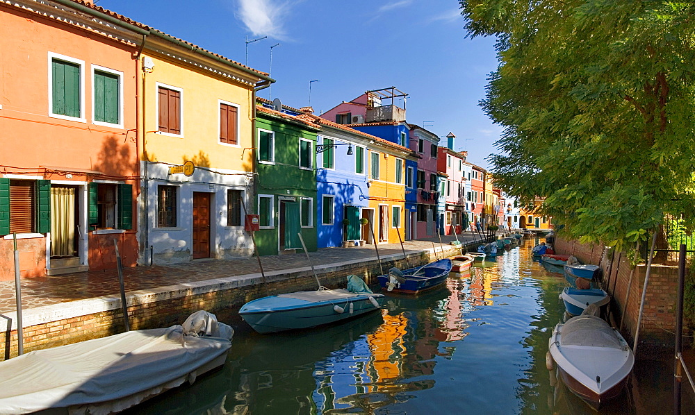 Panoramic view of the city and the colorfully painted houses and canals of Burano, Venice, Italy, Europe