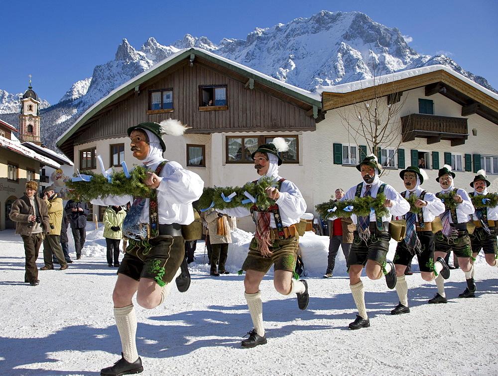 """""""Schellenruehrer"""" bell ringers, carnival, Parish church, Karwendelgebirge mountains, Mittenwald, Werdenfels, Upper Bavaria, Bavaria, Germany, Europe"""