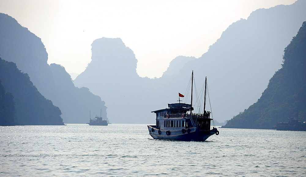 Ship in front of rock formations, Halong Bay, Vietnam, Southeast Asia