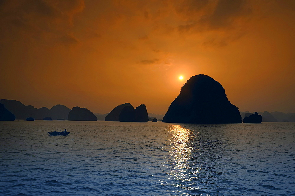 Fishing boat at sunset, Halong Bay, Vietnam, Southeast Asia