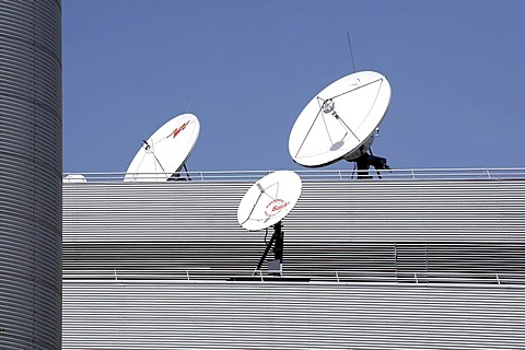 Satellite dishes on the roof of the headquarters and broadcasting centre of the RTL Group, Radio Television Luxembourg, in Luxembourg, Europe
