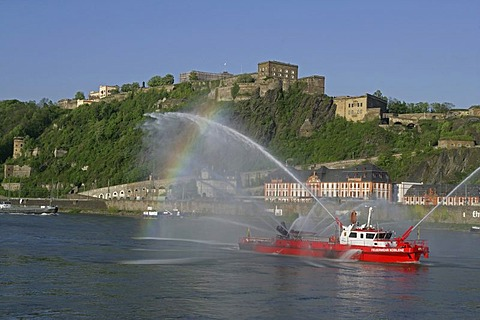 The fire-fighting boat of the fire brigade Koblenz on the Rhine river in front of the Festung Ehrenbreitstein fortress, Koblenz, Rhineland-Palatinate, Germany, Europe