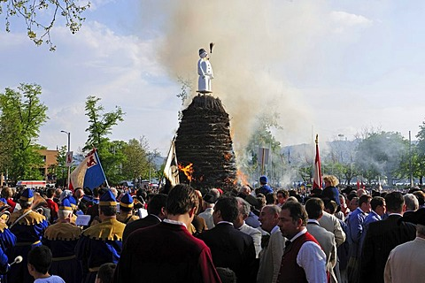 The Boeoeg, a doll symbolizing winter, is burned at the Sechselaeuten, traditional festival; the various guilds stand and ride around the fire, Zurich, Switzerland, Europe
