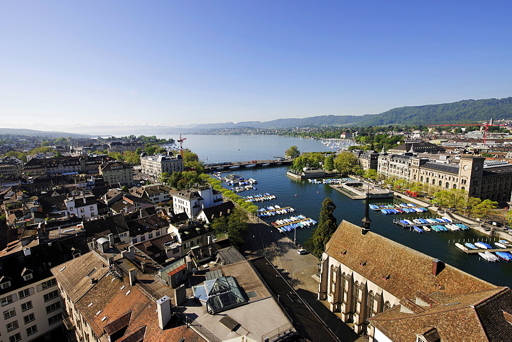 View from one of the towers of Grossmuenster, Great Minster Church, over the Limmat River, Quaibruecke bridge and Lake Zurich, Zurich, Switzerland, Europe